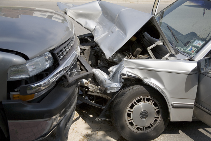 head on collision between car and truck
